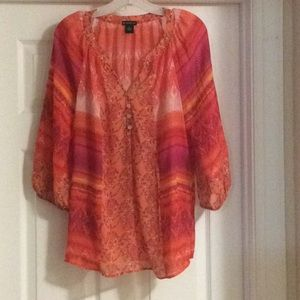 Burnt colored blouse perfect for office.